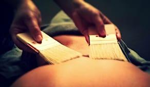 Massaggio con pennelli